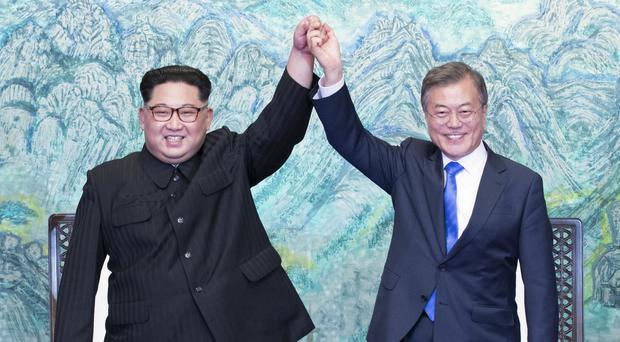 North Korean leader Kim Jong Un, left, and South Korean President Moon Jae-in (AP)