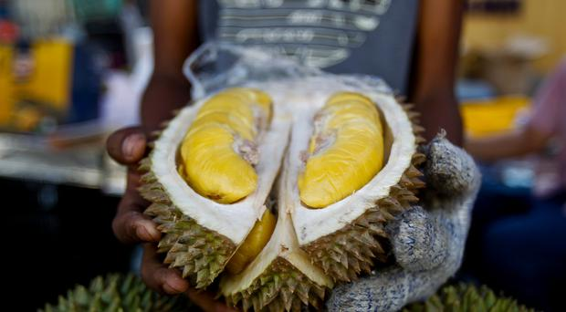 The durian fruit sparked an evacuation (Sadiq Asyraf/AP)