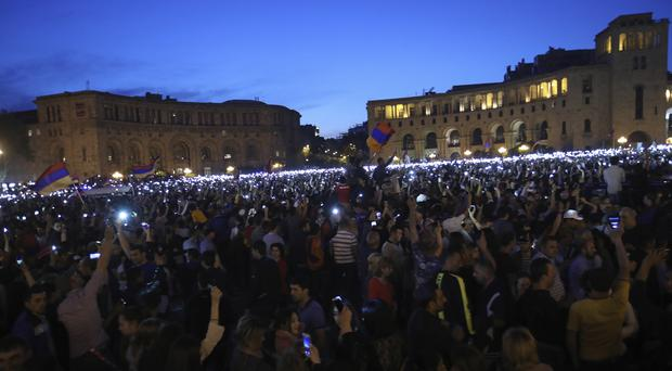 Supporters of opposition leader Nikol Pashinian protest in Republic Square in Yerevan (Thanassis Stavrakis/AP)