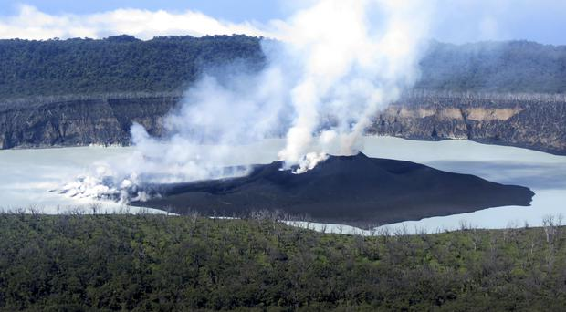 Steam rises from the volcanic cone that has formed in Lake Vui near the summit of Ambae Island, Vanuatu (Brad Scott/GeoHazards Divison, VMGD via AP)