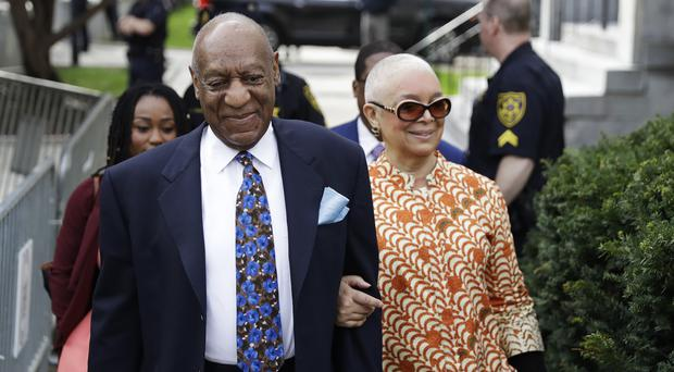 Bill Cosby, left, arrives at acourt with his wife, Camille. (Matt Slocum/AP)