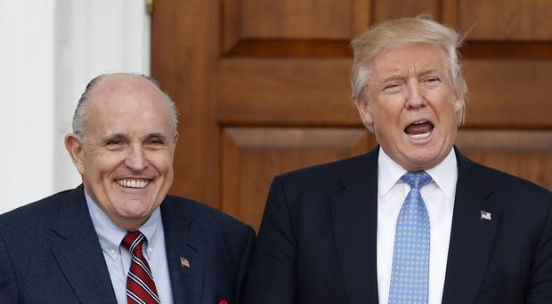 Mr Giuliani had said 'you won't see daylight between me and Mr Trump' (Carolyn Kaster/PA)
