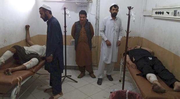 Injured men receive treatment at a hospital following a deadly bombing at a mosque in Khost city, Afghanistan (Nishanuddin Khan/AP)