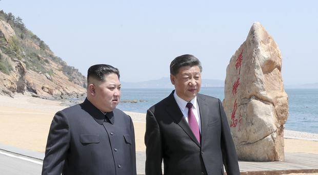 A stroll on the beach by Kim Jong Un and Xi Jinping (AP)