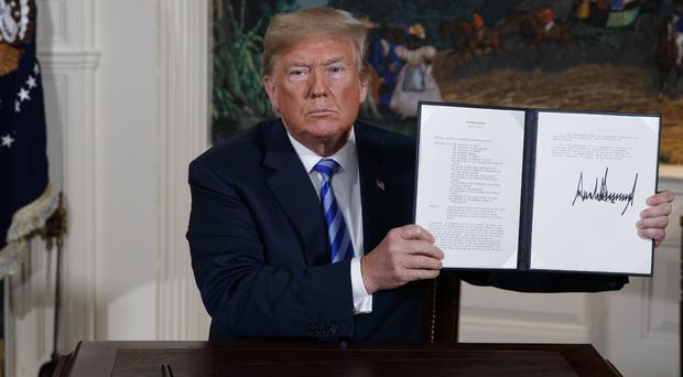 President Donald Trump with the signed presidential memorandum (Evan Vucci/AP)