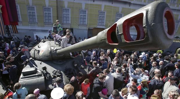 Youngsters climb a Soviet IS-3, Joseph Stalin-3 heavy tank (AP)