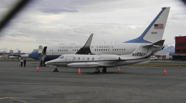 A US government plane holding the three Americans detained in North Korea sits on the tarmac at Ted Stevens Anchorage International Airport waiting to be refueled (Mark Thiessen/AP)