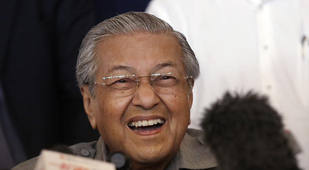 Mahathir Mohamad's press conference was peppered with trademark wisecracks (AP)
