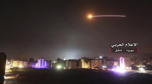 Israeli missiles hit air defence positions and other military bases in Damascus, Syria (Syrian Central Military Media, via AP)