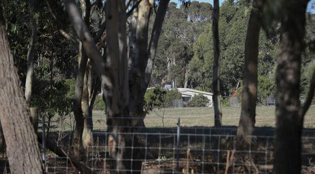 A property where police are investigating the deaths of seven people in Australia (Richard Wainwright/AAP Image via AP)