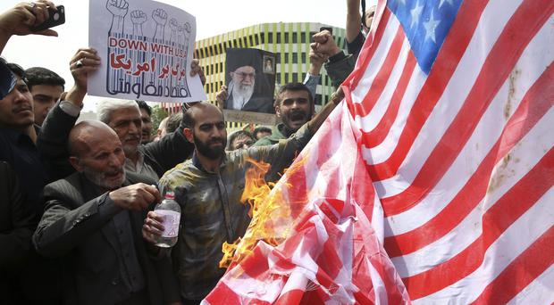 Iranian protesters rally in Tehran (Vahid Salemi/AP)