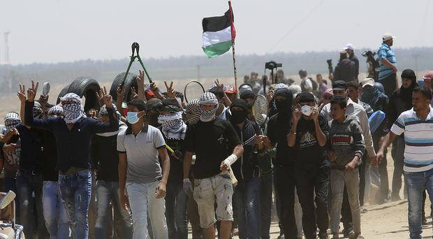 Protests at the Gaza Strip's border with Israel (Adel Hana/AP)