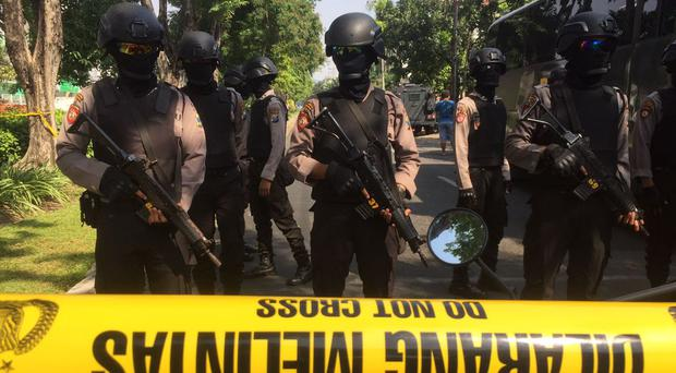 Police officers near the scene of the explosion in Surabaya, East Java (Trisnadi/AP)