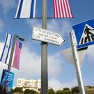 A road sign leading to the US embassy is seen ahead of the official opening in Jerusalem (Ariel Schalit/AP)