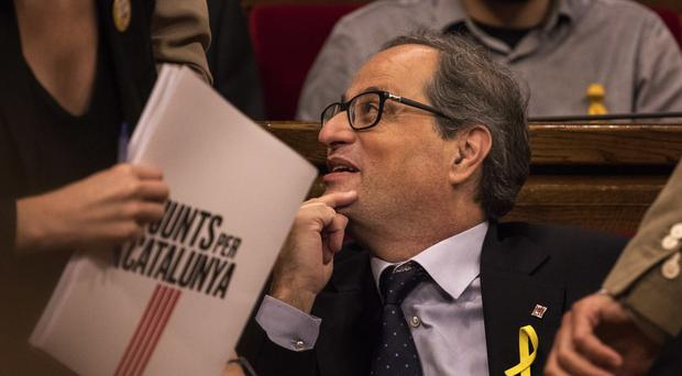 Separatist lawmaker Quim Torra sits on his parliamentary seat in Barcelona (Emilio Morenatti/AP)