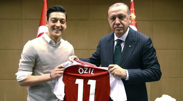 Recep Tayyip Erdogan poses for a photo with Turkish-German Arsenal football player Mesut Ozil in London (Presidential Press Service/Pool via AP)