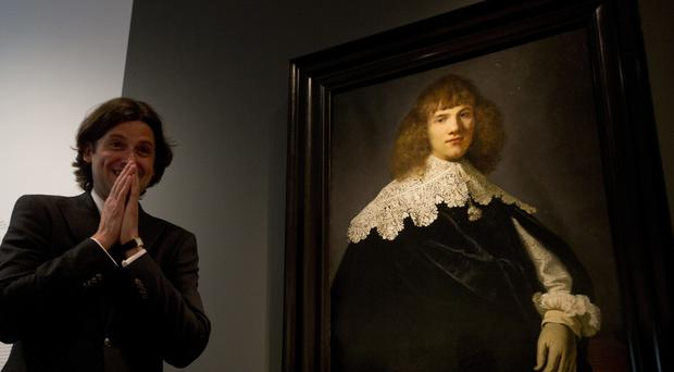 Art dealer Jan Six with the painting (AP)