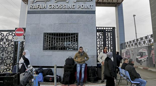 Palestinians wait to cross the border to the Egyptian side at Rafah crossing (Adel Hana/AP)