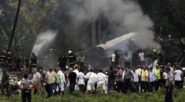 Cuba's President Miguel Diaz-Canel, third from left, walks away from the site where a Boeing 737 crashed (Enrique de la Osa/AP)
