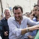 Leader of the League party, Matteo Salvini, arrives to address a rally in Fiumicino, near Rome (ANSA/AP)