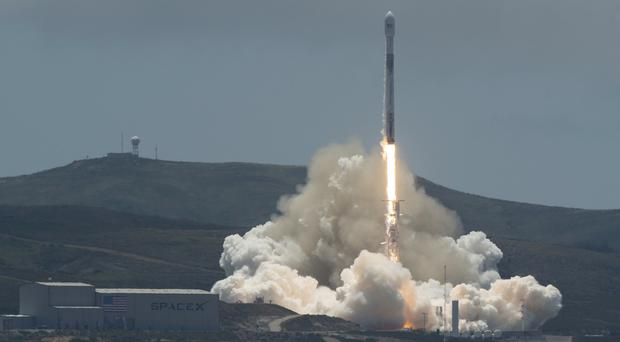 A SpaceX Falcon 9 rocket with a pair of US-German science satellites and five commercial communications satellites takes off from Space Launch Complex 4E at Vandenberg Air Force Base in California (Bill Ingalls/Nasa via AP)