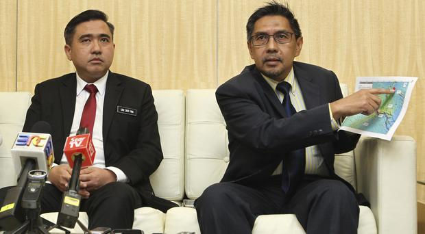 Director general of the Malaysian Department of Civil Aviation, Azharuddin Abdul Rahman, right, shows the search area map as Malaysia's new transport minister Anthony Loke Siew Fook looks on in Putrajaya (AP)