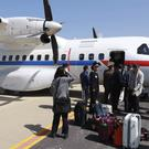 South Korean journalists arrive at Kalma Airport in Wonsan, North Korea (Yonhap via AP)