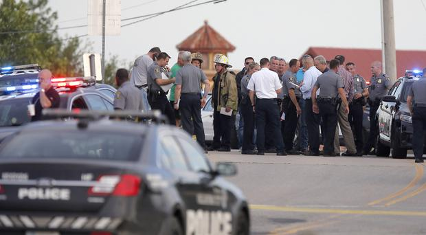 Emergency services at the scene of the shooting (Bryan Terry/The Oklahoman via AP)