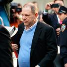 Film producer Harvey Weinstein surrenders to the authorities in New York yesterday