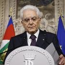 Sergio Mattarella said he had repeatedly asked for a minister who would not be perceived as entertaining Italy's exit from the euro (Fabio Frustaci/ANSA via AP)