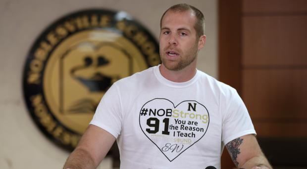 Jason Seaman, a seventh grade science teacher at Noblesville West Middle School in Noblesville, Ind., speaks to the media (Michael Conroy/AP)