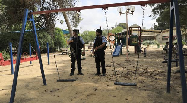 Israeli police officers guard a playground near the Israel and Gaza border (Tsafrir Abayov/AP)