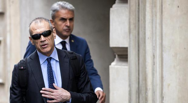Premier-designate Carlo Cottarelli arrives at Montecitorio Palace (AP)