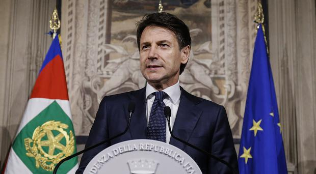 Giuseppe Conte addresses the media at the Quirinale presidential palace in Rome (AP)