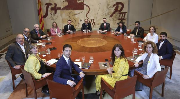 Catalan President Quim Torra poses with the members of the new government (Jordi Bedmar Pascual/AP)