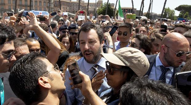 Leader of the League party and Italian Interior Minister, Matteo Salvini, walks through the crowd (Claudio Peri/ANSA via AP)