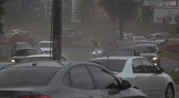 Drivers make their way through a rain of volcanic ash (Luis Soto/AP)