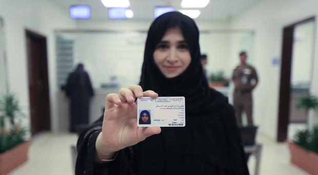 Tahani Aldosemani, Assistant Professor at Prince Sattam Bin Abdulaziz University in Al-Kharj, displays her brand new driving licence, at the General Department of Traffic in Riyadh (Saudi Information Ministry via AP)