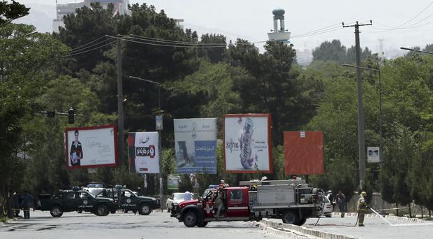 Security personnel at the site of a deadly suicide attack in Kabul (Massoud Hossaini/AP)