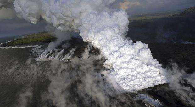 A laze (lava haze) plume rising from the northern side of the fissure 8 lava flow margins in the former Kapoho Bay at the town of Kapoho on the island of Hawaii (US Geological Survey/AP)