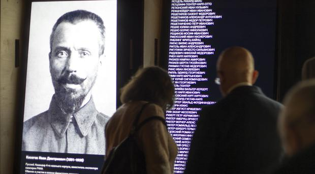 Visitors look at an exposition at the opening of the Gulag history museum in Moscow(AP)