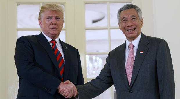 Donald Trump met Singapore's Prime Minister Lee Hsien Loong ahead of the summit (Evan Vucci/AP)