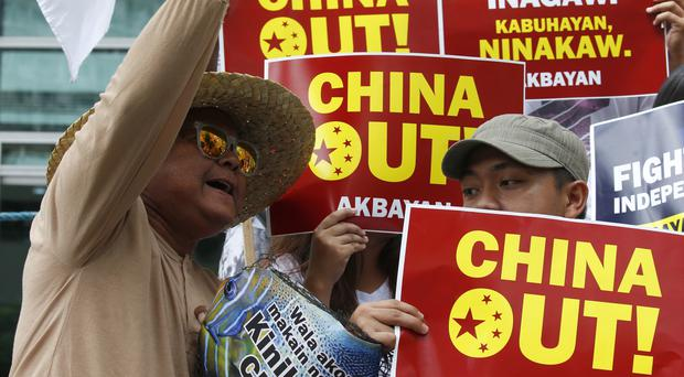 Demonstrations over alleged seizure of catches of Filipino fishermen at a disputed shoal in the South China Sea (AP)