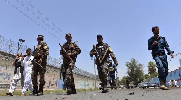Afghan security personnel arrives at the site of suicide attack in the city of Jalalabad east of Kabul, Afghanistan (AP)