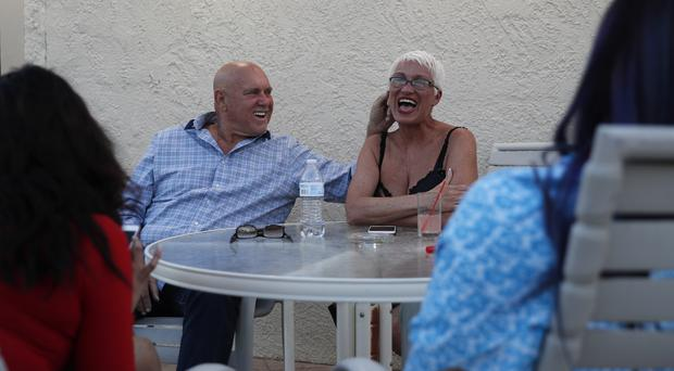 Dennis Hof, left, jokes with madam Sonja Bandolik at the Love Ranch brothel (AP Photo/John Locher)