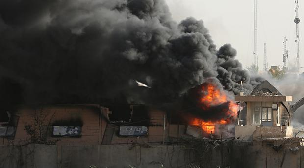A fire at Baghdad's largest ballot box storage site (AP)