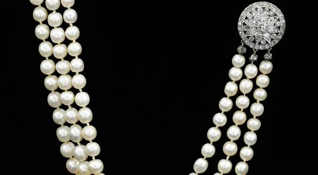 A natural pearl and diamond necklace that once belonged to Marie Antoinette (AP)