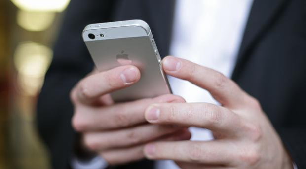 Apple is closing a security gap that allowed outsiders to pry data from locked iPhones (Yui Mok/PA)