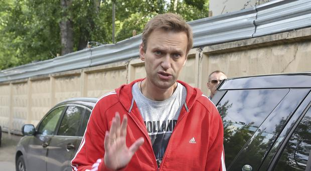 Alexei Navalny greets colleagues (AP Photo/Dmitry Serebryakov)