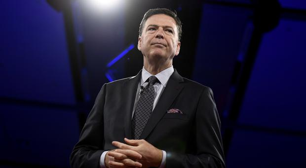 Former FBI director James Comey's actions have been investigated by a watchdog (Justin Tang/PA)